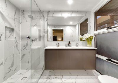 Bardon Bathroom Renovation in Calacatta marble look porcelain tiles and custom Titanium grey matt Cabinetry - Brisbane Builder