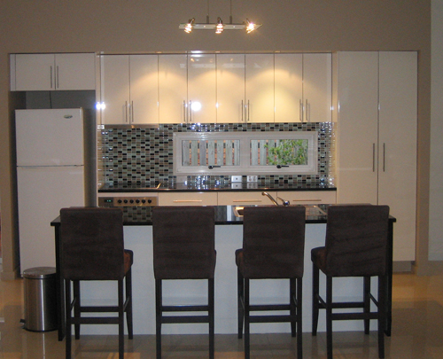Hendra Kitchen Renovation - White gloss kitchen with glass tile splash back and granite bench top