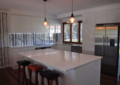 White on white finger pull glass wallpaper splash back Kitchen