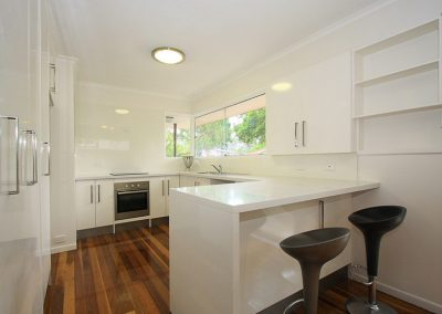 White on white gloss compact Kitchen in Indooroopilly