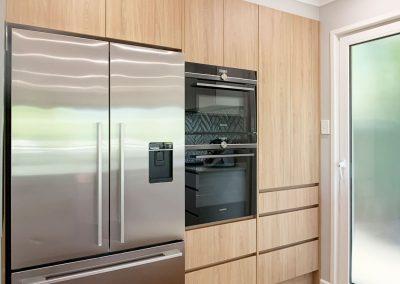 Appliance Wall in Woodgrain Cabinetry