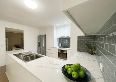 White Kitchen with Grey Accents