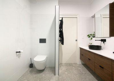 In Wall Cistern Toilet - Dark Woodgrain Vanity & Black Accessories
