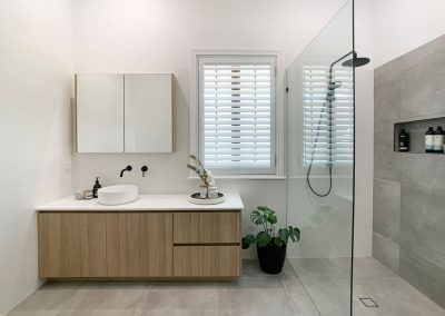 Woodgrain Shaving Cabinet & Vanity - Grey floor and feature wall tile.
