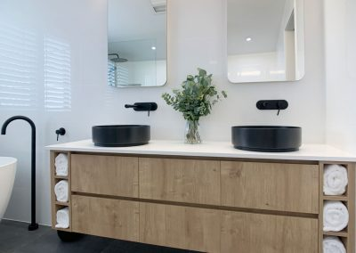 Dual Vanity & Shaving Cabinets - Overhead Lighting and Black Accessories