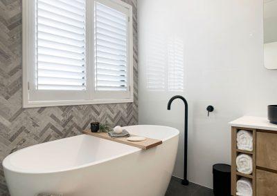 Herringbone Feature Wall - Freestanding Bath with Black Bath Spout
