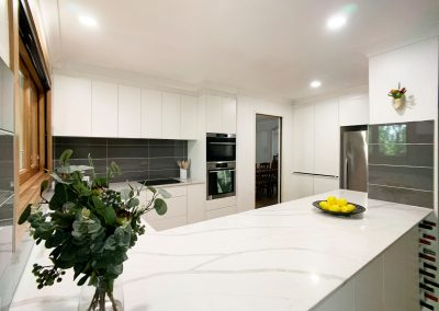 Servery Kitchen - White cabinetry and stone