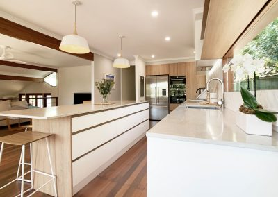 Beautiful Woodgrain Kitchen - White Cabinetry with Stone Benchtops