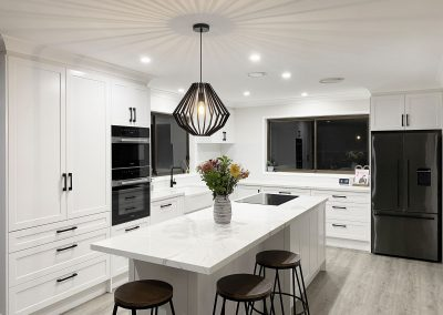 Full White and Black Kitchen with Pendant Lighting